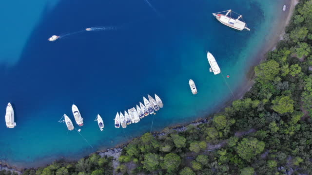 Aerial view of Mediterranean island seashore with boats