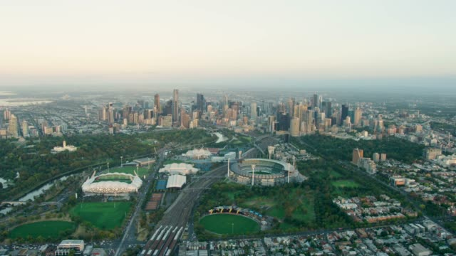 aerial view of melbourne city skyline at sunrise - stadium stock videos & royalty-free footage