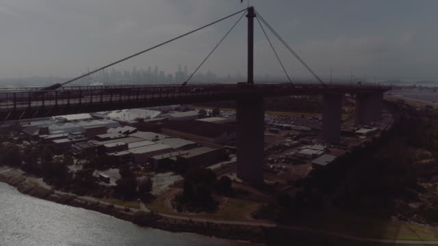 aerial view of melbourne's west gate bridge. melbourne australia - cable stayed bridge stock videos & royalty-free footage