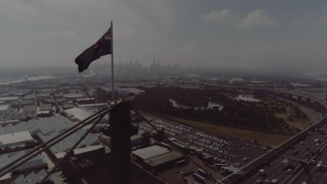 aerial view of melbourne's west gate bridge with australian flag. melbourne australia - cable box stock videos & royalty-free footage