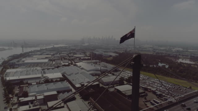 aerial view of melbourne's west gate bridge with australian flag. melbourne australia - cable stayed bridge stock videos & royalty-free footage