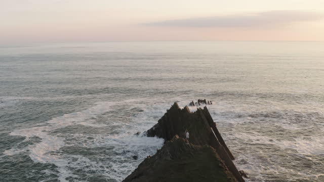 aerial view of men standing on summit of sea cliff - aircraft point of view stock videos & royalty-free footage