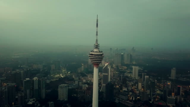 aerial view of menara kuala lumpur tower - malaysia - menara kuala lumpur tower stock videos and b-roll footage