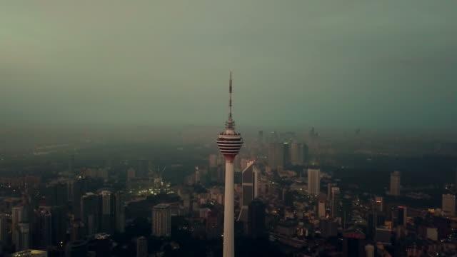aerial view of menara kuala lumpur tower - malaysia - menara kuala lumpur tower stock videos & royalty-free footage