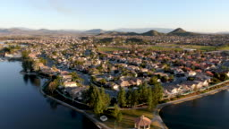 Aerial view of Menifee Lake and neighborhood, residential subdivision vila during sunset
