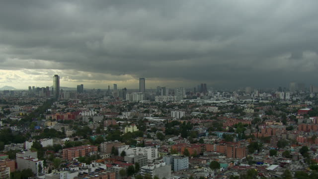 Aerial view of Mexico City with approaching storm off in the distance.