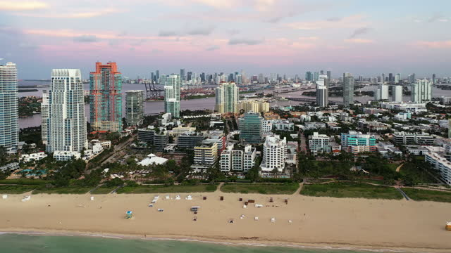vidéos et rushes de aerial view of miami beach and city at sunrise, florida - miami