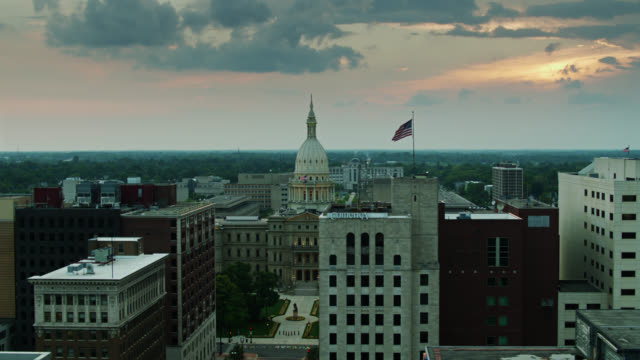 aerial view of michigan state capitol building through downtown hotels and offices - lansing stock videos & royalty-free footage