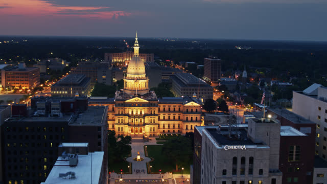 aerial view of michigan state capitol on summer night - lansing stock videos & royalty-free footage