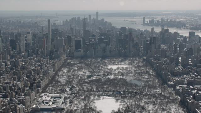 aerial view of midtown manhattan and central park on a sunny winter day. - central park manhattan video stock e b–roll