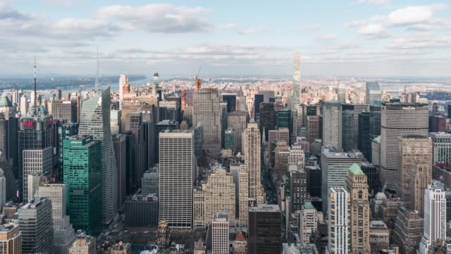 t/l aerial view of midtown manhattan and skyscraper in sunlight / nyc - midtown manhattan stock videos & royalty-free footage