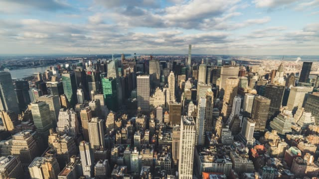 T/L WS HA Aerial View of Midtown Manhattan and Skyscraper in Sunlight / NYC