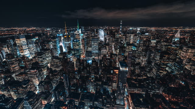 t/l aerial view of midtown manhattan skyline at night / nyc - empire state building stock videos & royalty-free footage