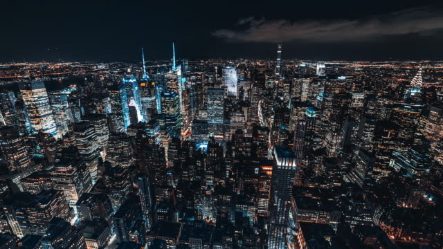 t/l aerial view of midtown manhattan skyline at night / nyc - new york state stock videos & royalty-free footage