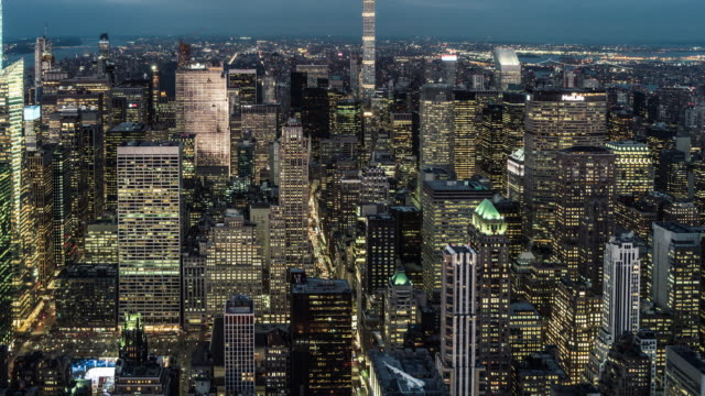 t/l tu aerial view of midtown manhattan skyline, from dusk to night / nyc - prosperity stock videos & royalty-free footage