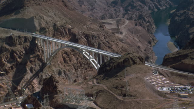 aerial view of mike o'callaghan–pat tillman memorial bridge on colorado river at hoover dam in nevada. - clark county nevada stock videos & royalty-free footage