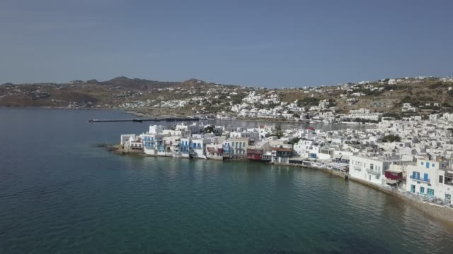 aerial view of mikri venetia or little venice at mykonos town in greece greek island mykonos waits for tourism relief the island depends on tourism... - mykonos stock videos & royalty-free footage