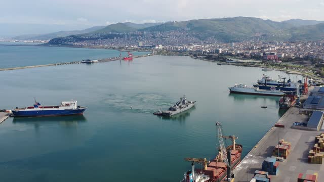 aerial view of military war ship approaching to a commercial port. - pier stock videos & royalty-free footage