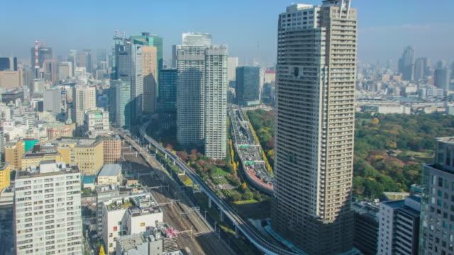 /l ws: 東京都港区の空撮 - 列車の車両点の映像素材/bロール