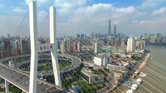 aerial view of modern bridge in midtown of modern city - suspension bridge stock videos & royalty-free footage