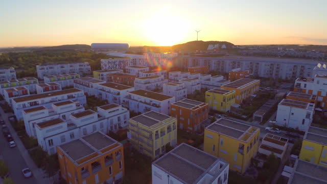 ws aerial view of modern housing development at sunrise - 住宅開発点の映像素材/bロール