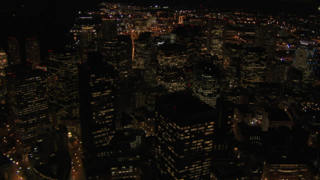 aerial view of modern skyscrapers at night in downtown boston, massachusetts, united states of america - custom house tower stock videos & royalty-free footage