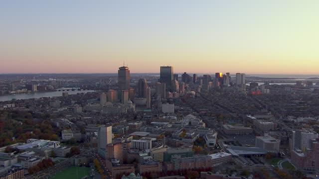 aerial view of modern skyscrapers during sunrise in downtown boston, massachusetts, united states of america - チャールズ川点の映像素材/bロール