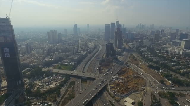 aerial view of modern tel aviv with ayalon highway, azrieli towers and ramat gan financial district - tel aviv stock-videos und b-roll-filmmaterial