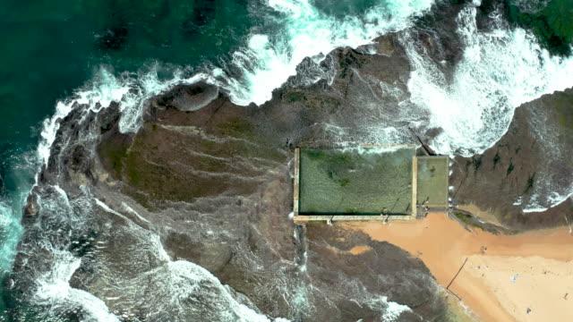aerial view of mona vale ocean pool, nsw, australia - standing water stock videos & royalty-free footage