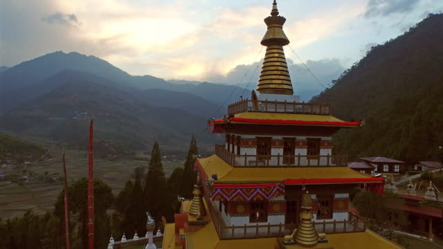 aerial view of monastery on hill with sunset - bhutan stock videos & royalty-free footage