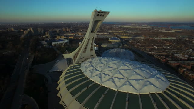 aerial view of montreal olympic stadium - montréal stock-videos und b-roll-filmmaterial