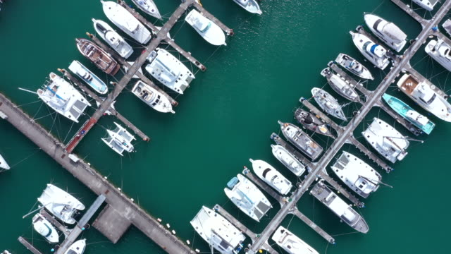 aerial view of moored boats in harbor - passenger ship stock videos & royalty-free footage