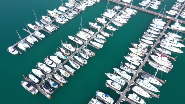 aerial view of moored boats in harbor - marina stock videos & royalty-free footage