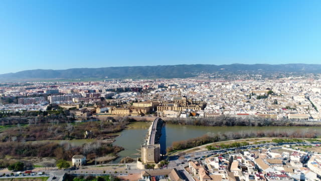 aerial view of mosque-cathedral and roman bridge of cordoba - cathedral stock videos & royalty-free footage