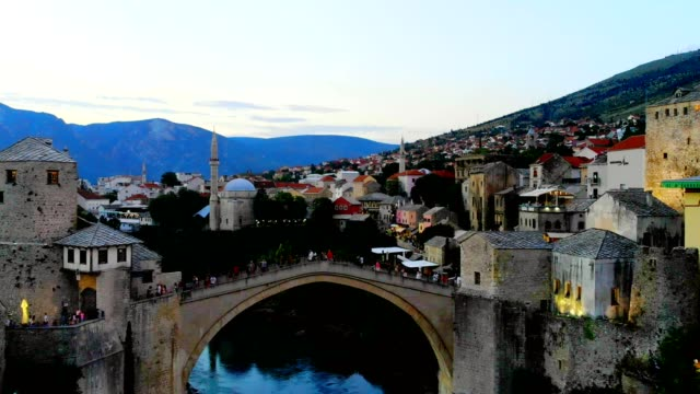 aerial view of mostar city and neretva river - bosnia and hercegovina, - bridge built structure stock videos & royalty-free footage