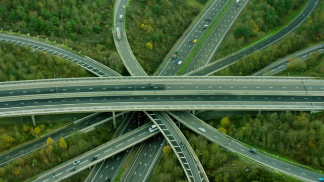 aerial view of motorway system outside london uk - m25 video stock e b–roll