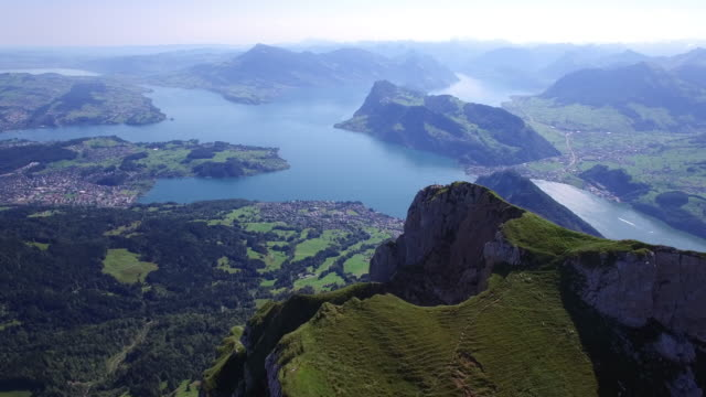 aerial view of mountain landscape with lake. helicopter shot of european alps. - establishing shot stock videos & royalty-free footage
