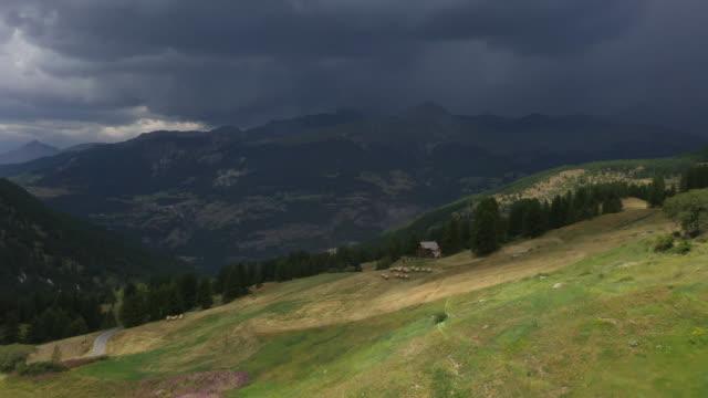 vidéos et rushes de aerial view of mountain landscape with stormy sky - prairie