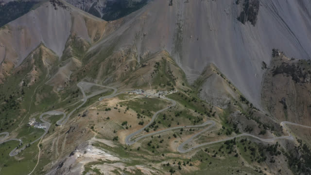 vidéos et rushes de aerial view of mountain pass and summit - french culture