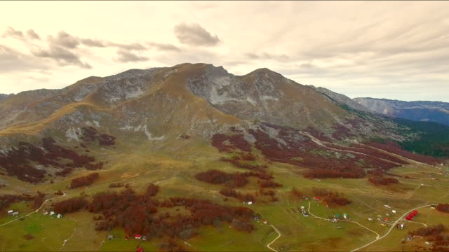 Aerial view of mountain peak and valley near Zabljak 4K