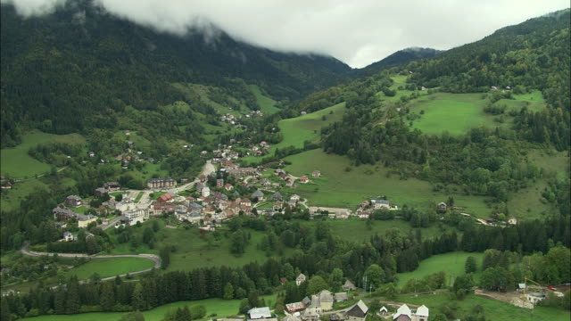 ws aerial view of mountain village near grenoble, rhone-alpes, france - grenoble stock-videos und b-roll-filmmaterial