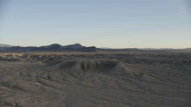 Aerial View Of Mountains And Desert During Sunset