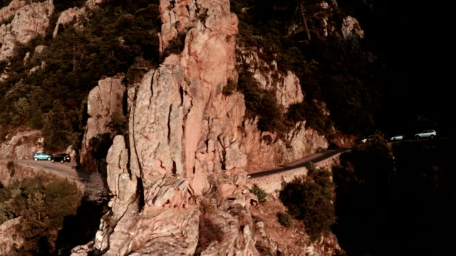 stockvideo's en b-roll-footage met aerial view of mountains of calanche of piana - bergketen