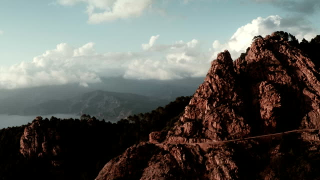 aerial view of mountains of calanche of piana - rock type stock videos and b-roll footage