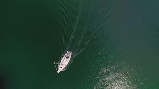 aerial view of moving boat in sea. - sailor stock videos & royalty-free footage
