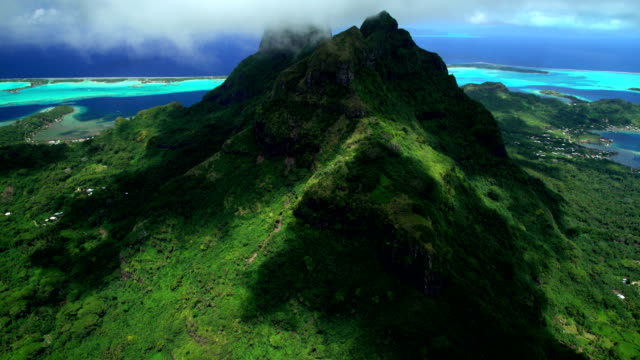 aerial view of mt otemanu bora bora island - french polynesia stock videos & royalty-free footage