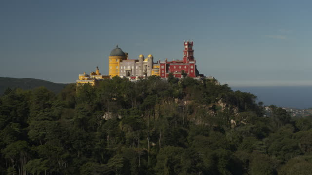 aerial view of multicolor castle on hill / sintra, lisboa, portugal - lisbon stock videos and b-roll footage