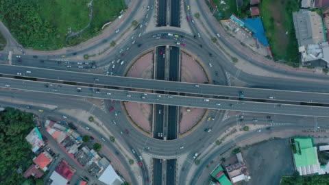 aerial view of multiple lane circle road traffic - traffic circle stock videos & royalty-free footage