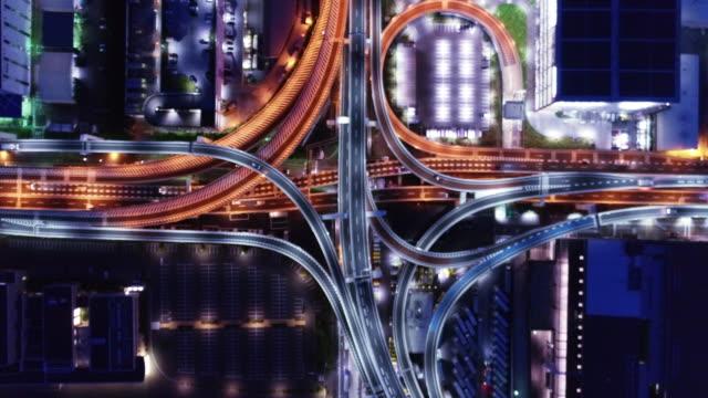 aerial view of multiple lane highway at night - 高速道路点の映像素材/bロール