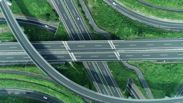 aerial view of multiple lane highway in nature - 高速道路点の映像素材/bロール